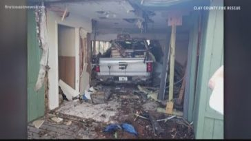 Truck crashes into Orange Park home, family displaced