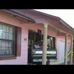 Stolen truck crashes into home