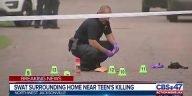 SWAT surrounding home near teen's killing